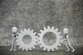 3d man- businessmen  pushing  two gear wheels
