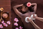 Woman Enjoying Herbal Massage At Spa