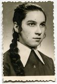 LODZ, POLAND, CIRCA MAY 1972 - Vintage photo of young girl with a braid