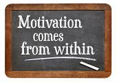 motivation comes from within phrase on a vintage slate blackboard