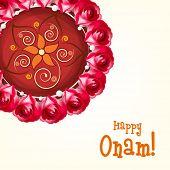 Beautiful rangoli decorated with flowers and stylish text Happy Onam.