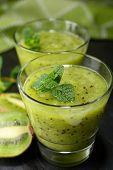 Kiwi fruit smoothie in a glass closeup
