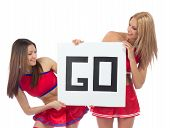 stock photo of cheerleader  - Cheerleader dancer girls from cheerleading team smiling hold sign in hand for text space isolated on a white background - JPG