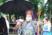 MUSKOGEE, OK - MAY 24: A man dressed in costume enjoys the Oklahoma 19th annual Renaissance Festival