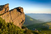 rock in Carpathian mountains lighted evening sky