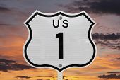 US highway one sign with sunrise sky.