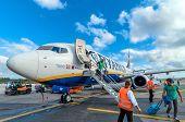 Passengers Deplane Ryanair Jet Airplane After Landing In Pisa Airport, Italy