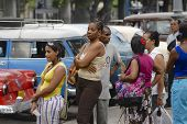 People wait in the queue for taxi in Havana, Cuba.