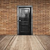 Red Brick Wall, Black Door And Wooden Floor