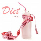 Bottle of yogurt with measuring tape isolated on white, Diet concept