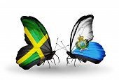 Two Butterflies With Flags On Wings As Symbol Of Relations Jamaica And San Marino