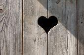 pic of wooden door  - heart on a wooden door in summer - JPG