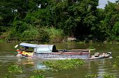 Loaded River Boat In Thailand