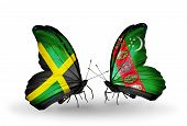 Two Butterflies With Flags On Wings As Symbol Of Relations Jamaica And Turkmenistan
