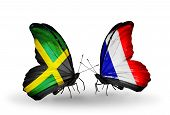 Two butterflies with flags on wings as symbol of relations Jamaica and France
