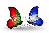 Two Butterflies With Flags On Wings As Symbol Of Relations Portugal And Honduras