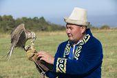 Man feeds falcon, Almaty, Kazakhstan.
