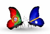 Two Butterflies With Flags On Wings As Symbol Of Relations Portugal And Nauru