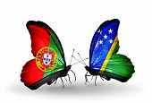 Two Butterflies With Flags On Wings As Symbol Of Relations Portugal And Solomon Islands