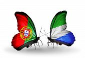 Two Butterflies With Flags On Wings As Symbol Of Relations Portugal And Sierra Leone