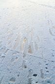 Footprints on the slippery ice