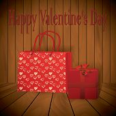 Valentine Day Realistic Red Shopping Bag With Wraped Present On Wooden Background
