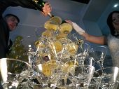 Buzuluk, Russia - September 19, 2014: The Wedding. Unknown Couple Poured Champagne Into The Glasses.