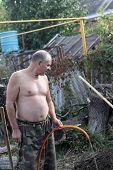 Man Watering Seedling
