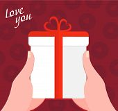 hands holding a gift box with a ribbon - flat design vector