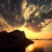Beautiful sunrise over the sea on a background of mountains of Crimea