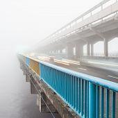 Metro bridge in Kiev in the fog at dawn