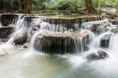 Waterfall In The Deep Forest In Thailand