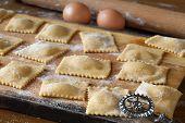 Raw Agnolotti Pasta On Cutting Board