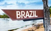 Brazil wooden sign with a lake background
