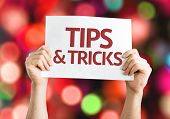 Tips & Tricks card with colorful background with defocused lights