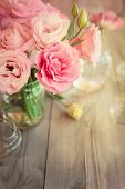 Bright romantic vertical background with roses and bokeh, copy space for text