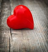 Red Heart On Wooden Background. Love And  Valentines Day. Vignette