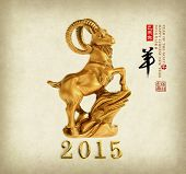 2015 is year of the goat,Gold Chinese with calligraphy mean happy new year. translation: sheep, goat