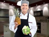 Smiling professional chef man in modern kitchen