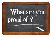 What are you proud of  - a question in white chalk text  on a vintage slate blackboard