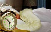 Sleeping Women And Alarm Clock