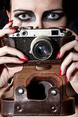 Young beautiful girl with a vintage camera