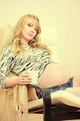 Happy pregnant woman relaxing at home. Family. Healthcare.