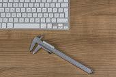 Keyboard And A Sliding Caliper On Desktop