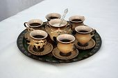 Six Coffee Cups And Sugar Bowl On Tray