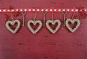 Happy Valentine's Day Red Vintage Wood Background With Hanging Gold Hearts And Ribbon Decorations, W