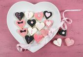 Pink, Black And White Homemade Heart Shape Cookies On White Heart Plate On Vintage Shabby Chic Pink
