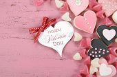 Pink, Black And White Homemade Heart Shape Cookies On Vintage Shabby Chic Pink Wood Background With