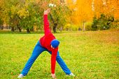 Morning Warm Up Of A Young Athlete On A Glade In Park In Autumn