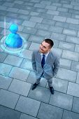 business, technology, connection and people concept - young smiling businessman with virtual screen and user icon outdoors from top